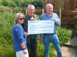 Rodley flood relief cheque presented