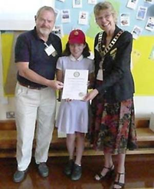 District Governor, Terry Kenyon (right) and Reading Maiden Erlegh Rotary Club President Tim Thorpe (left) presenting the RotaKids certificate to a Playground Friend