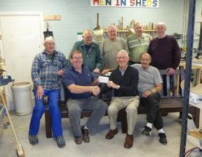 President Bruce Liddle with Adie and the team at Men In Sheds. The bench is now installed in Beeston by the tram station.