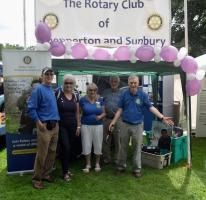 Rotary members selling crocuses in support of the End Polio Now Rotary Campaign