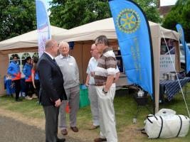 Club President Colin Green, (second from right), Club Secretary John Bush, (second from left), and Letchworth Howard member Mike Coleman (far right) chatting to a visitor to the club stand.