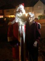 Santa greets a resident of Manor Road, Barton-le-Clay