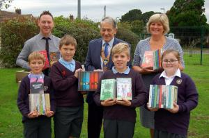 Christchurch Rotary buy books for St Joseph's Catholic Primary School