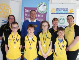 Rotary Club President Alan Fletcher with one of the teams entered by Swindon Dolphins