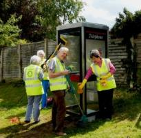 The team hard at work preparing the old phone box