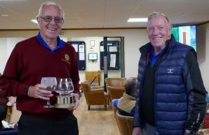 The winner receives his trophy and prize from organiser Dave Jarvis