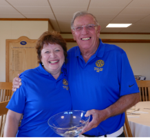 Event organiser. Dave Jarvis, presents winner, Jackie Wellman with the trophy