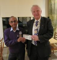 Rotary District 1190 (Lancashire & Cumbria) Chairman Vas Vasudev receiving a cheque for the 'END POLIO NOW'campaign from Black South President (2012/2013) Eric Hind.