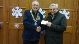 Ian hands a cheque to the Portland Archologists
