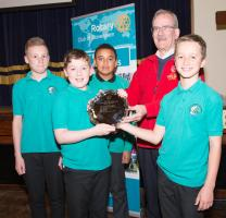 Assistant Governor, Ken McLennan presents winners, Hazlehead School, with their trophy