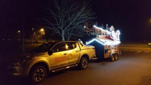 Rotarians help Father Christmas visit Bridport and the surrounding villages