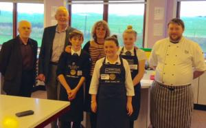 Picture shows Sam Finlayson, Hayley Nisbet and Adele Patterson with (L to R) Rotarians Fye Milligan, Ed Hunter, Sanquhar Academy Principal Teacher Curriculum Tricia Mitchell and Chef Will Pottinger.
