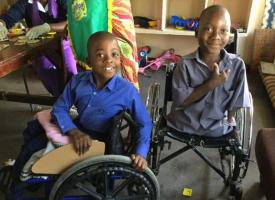 Happy faces with their new wheelchairs