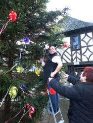 Past President Philippa and her husband Colin tying the bows on the tree