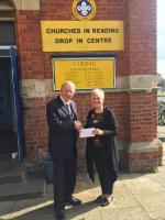 Club President Colin Maclean presenting the cheque to Centre Club Manager Mabel Boyd.