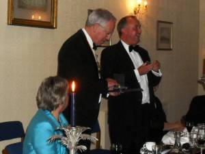 Outgoing President Roy Wood presents David Bruce with the Rotary Paul Harris Fellowship Award