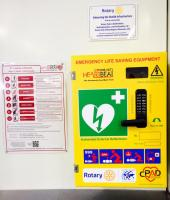 Milton Keynes Station Defibrillator,with instructions and a dedication plaque.