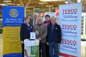 Installing our 'Vision Aid Overseas' collection box at Tesco Bourne on 4th November 2013