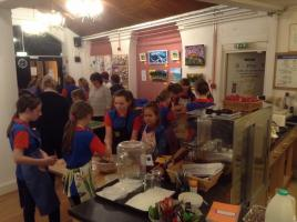 Guides make Christmas puddings for elderly people