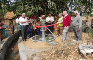 Monifieth Rotarians Nick Day (third from right) and Hugh Begg (second from right) along with members of Calcutta Rotary Club at the inauguration of a bore well in Nityanagar village in West Bengal during a visit to see progress on an earlier project.