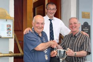 Picture shows Thornhill and District Rotary Club President Derek Clark presenting Gordon with his trophy. Looking on is event sponsor Robert Mitchell.