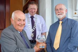 Picture shows Derek presenting the bowl to Iain. Looking on is current President Gordon Steele.