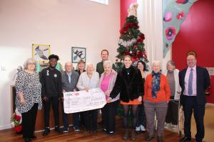 Interact presents cheque to the Fair Close Centre