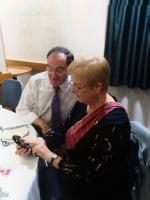 District Governor Olive, and Portobello President Lawrence chatting during the recent International Evening at Portobello