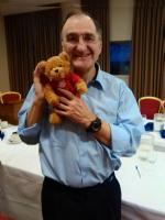 Lawrence holding Miles, the End Polio Now teddy bear.