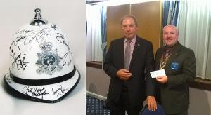 Auction of Signed Isle of Man Police Helmet Raises £650 for Charity - October 2015