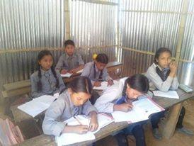 Children using their corrugated classroom