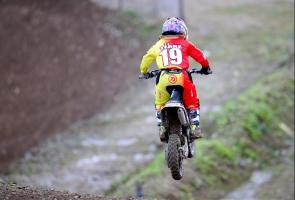 Young Motorcross Rider with Amniotic Band Syndrome supported