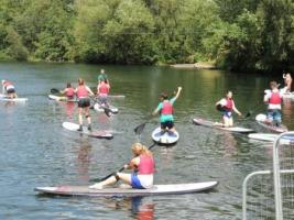 Paddle boarding at Youth Camp