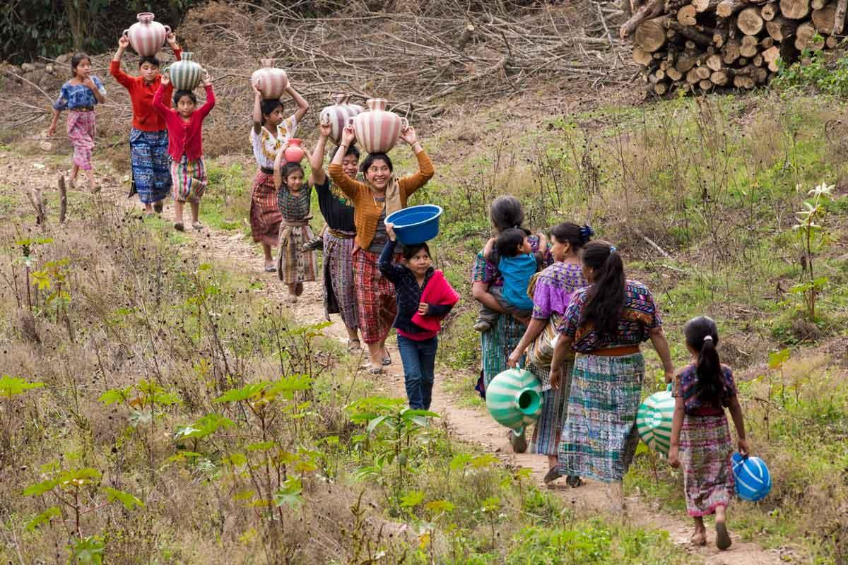 Women make their way to collect water for their families.  Rotary actively promotes  projects to provide clean water in poor areas abroad