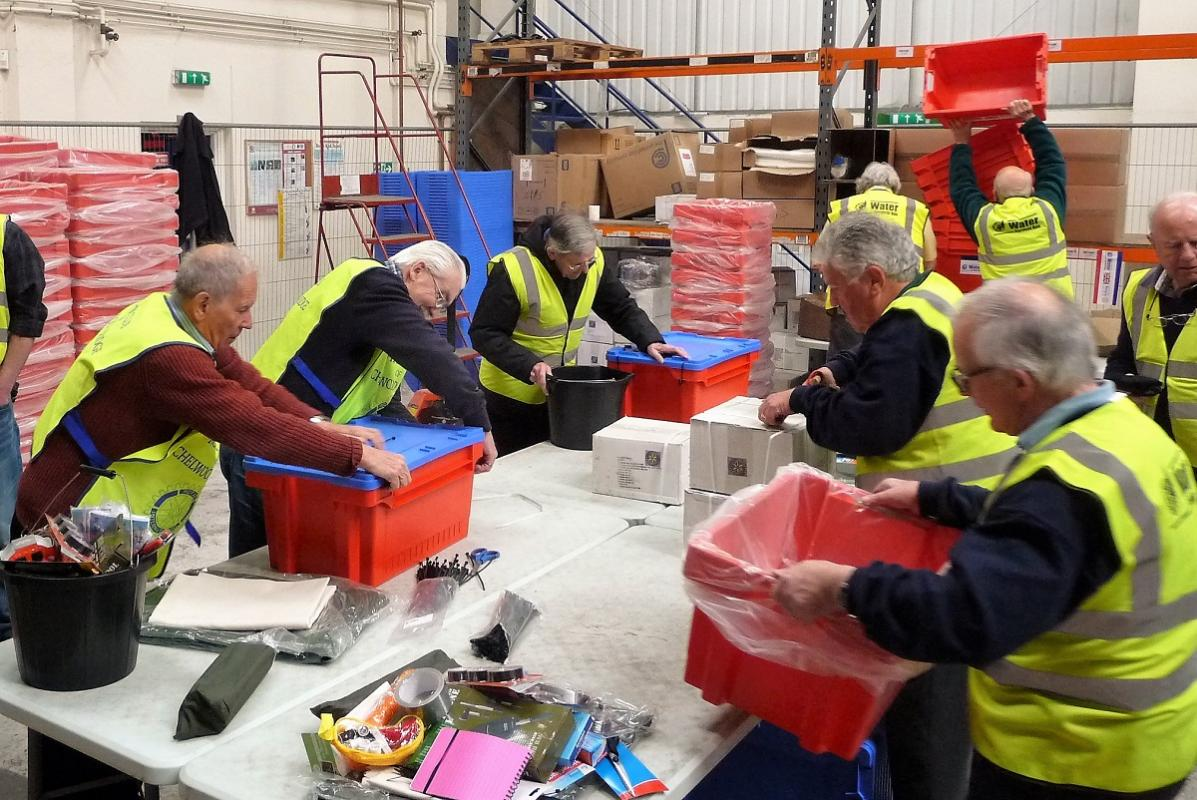 Rotarians packing Water Survival Boxes - Busy volunteers