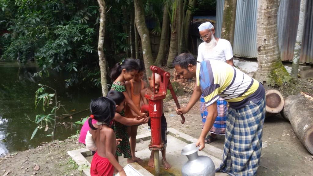 FRESH WATER FOR BANGLADESH - One of the new wells in action in the village of Bhongergaon