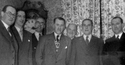Meeting of Millom Rotary Club in 1954 or 1955 showing Harry Heath, Donald Craft, Arthur Clegg, Ronnie Davis, Ted Driver, Donald Schiefler, and Dudley Grayson