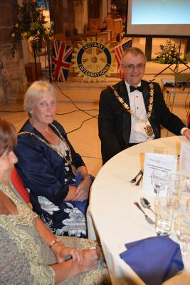 A mayor and mayoress sitting at a dining table with another guest