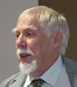 A bearded white-haired man