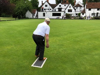 Rear view of a man playing bowls