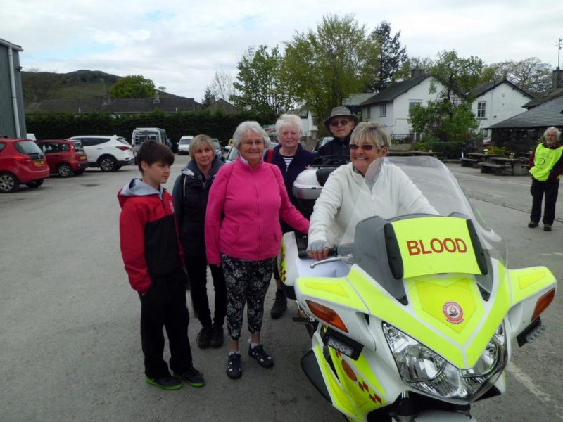 Margaret and walkers admiring a liveried blood bike