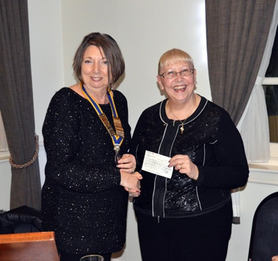 Helen collecting a cheque on behalf of Kirkwood Hospice.