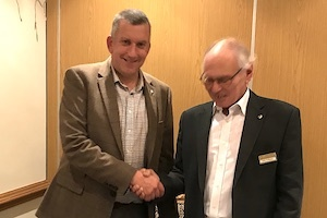 Alan Joy is welcomed into the club by President John Williams