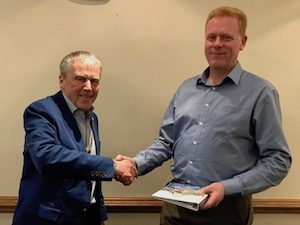 Matthew Tottle being welcomed to Rotary by President Chris Porter
