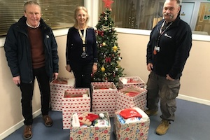 Rotarian Chris Porter delivering seven food boxes to The Quays at Christmas