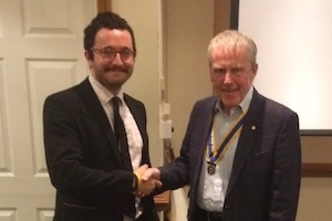 Sam Wood being welcomed to Rotary by President Chris Porter