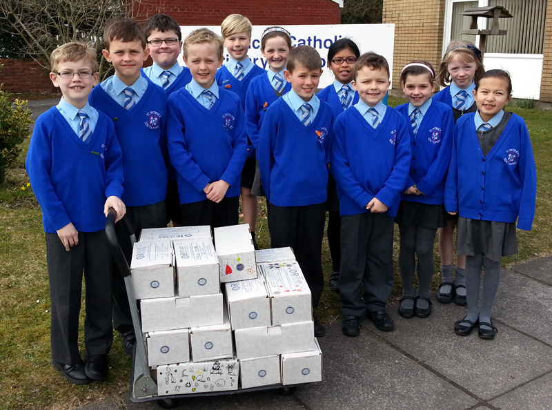 Pupils-of-St-Patricks-Primary-School-and some-of-their-filled shoeboxes.