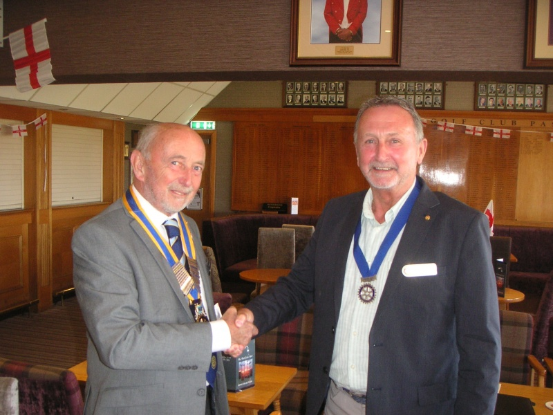 PE Brian is given his collarette by President Colin.