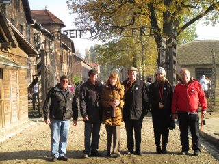 At the entrance to Auschwitz Concentration Camp
