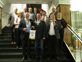 Members & guests on a visit to the Rotary Club of Katawice, Poland. In the forground are presidents Richard & Thomas